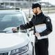 Policeman putting fine on the car - PhotoDune Item for Sale