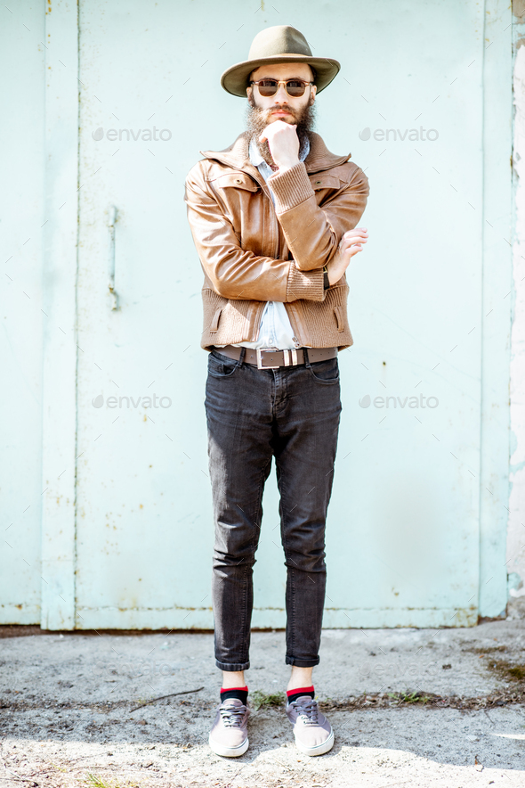 Portrait of a stylish man on the turquoise background - Stock Photo - Images