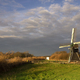 The Follega windmill under a heavy clouded sky - PhotoDune Item for Sale