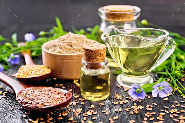 Oil flaxseed with flour and seeds on board - Stock Photo - Images
