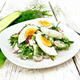 Salad with radish and egg in plate on wooden board - PhotoDune Item for Sale