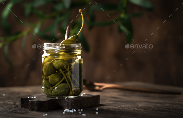 Marinated or pickled canned capers fruit - Stock Photo - Images
