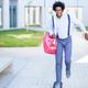 Black businessman riding skateboard near office building - PhotoDune Item for Sale