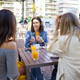 Multi-ethnic group of friends having a drink together in an outdoor bar - PhotoDune Item for Sale