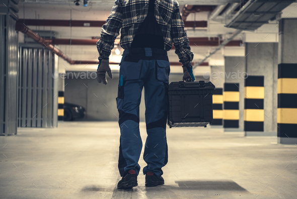 Technician Worker with Large Tools Box in Hands - Stock Photo - Images