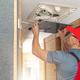 Men Repairing Air Condition Unit Inside Modern Travel Trailer - PhotoDune Item for Sale