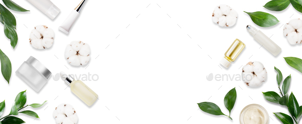 Glass and plastic cosmetic bottles with cotton flowers on white background banner. - Stock Photo - Images