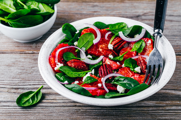 Citrus Spinach Salad with pecan and goat cheese or feta - Stock Photo - Images