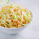 Traditional coleslaw salad with fresh sliced carrots and cabbage in a white bowl - PhotoDune Item for Sale