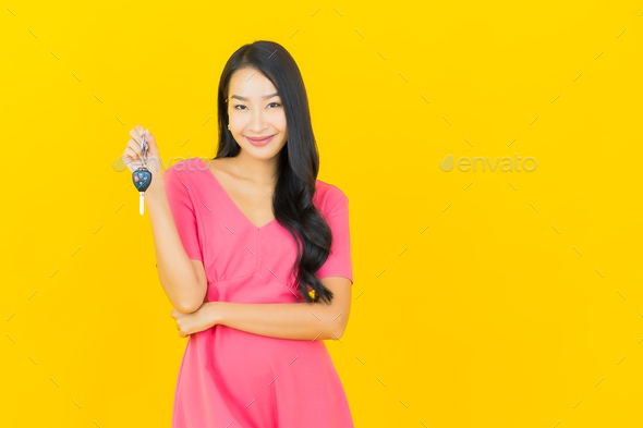 Portrait beautiful young asian woman smile with car key - Stock Photo - Images