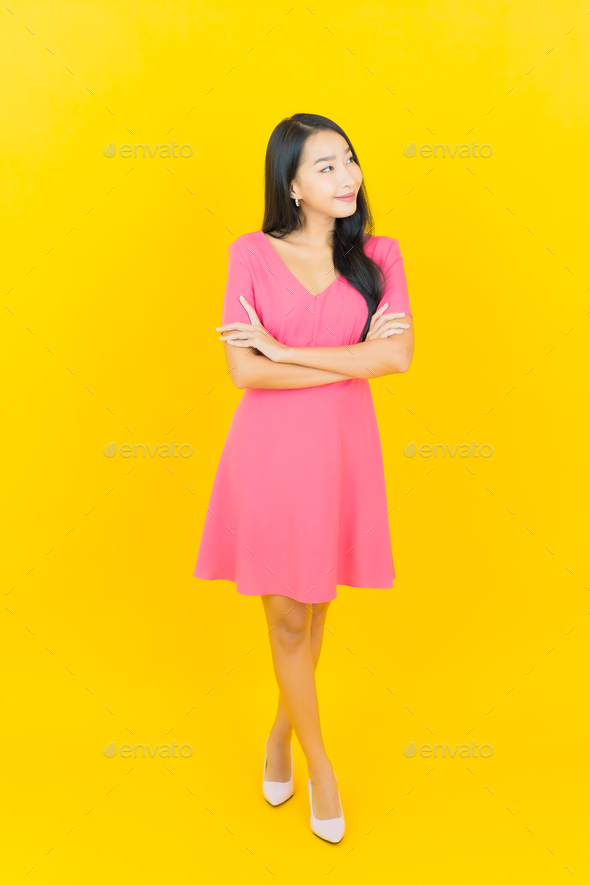 Portrait beautiful young asian woman smile with action - Stock Photo - Images