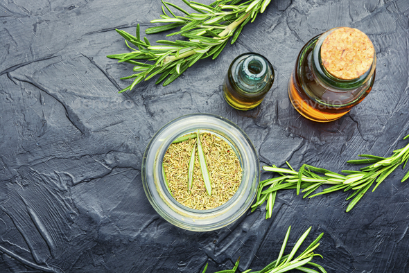 Fresh organic rosemary essential oil - Stock Photo - Images