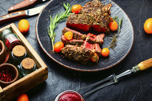 Juicy beef steak with kumquat - Stock Photo - Images
