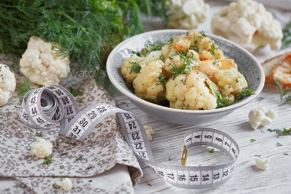 Cauliflower cooked with oil and herbs - Stock Photo - Images