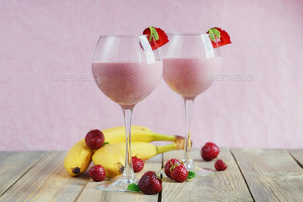 Delicious strawberry and banana smoothie, yogurt or milk shake with fresh berries - Stock Photo - Images