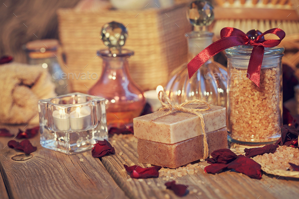 Natural handmade soap and sea salt with fragrant herbs - Stock Photo - Images