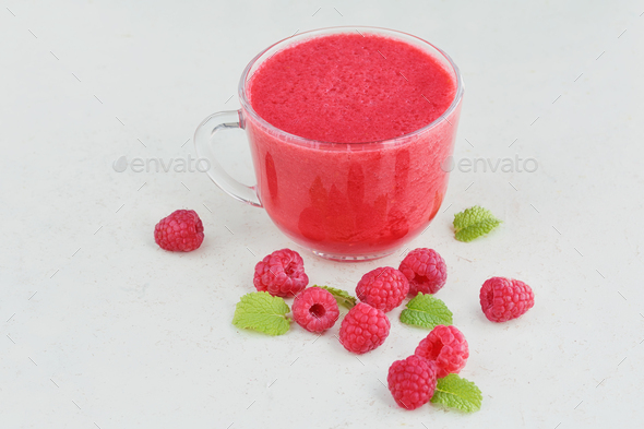 Delicious raspberry smoothie or milk shake with fresh berries - Stock Photo - Images