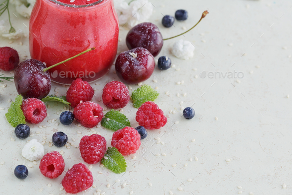 Delicious raspberry and sweet cherry smoothie or milk shake with fresh berries - Stock Photo - Images
