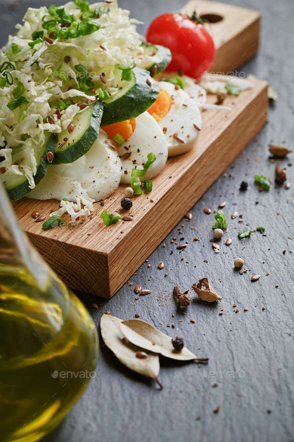 Healthy food ingredients with tomato, cucumber, cabbage, green onion, egg and spices - Stock Photo - Images