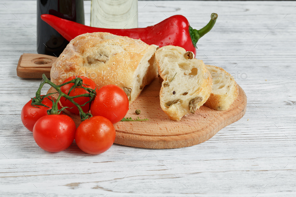 Sliced bread Ciabatta and vegetables. - Stock Photo - Images