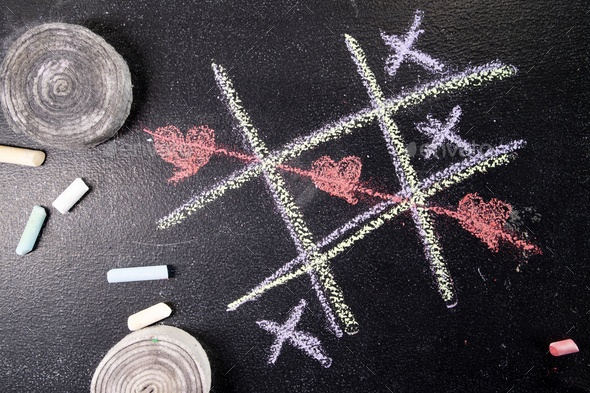 Tic-tac-toe game with heart as a symbol - Stock Photo - Images