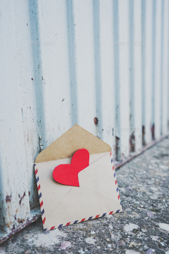 Little red hearts inside of an old envelope - Stock Photo - Images