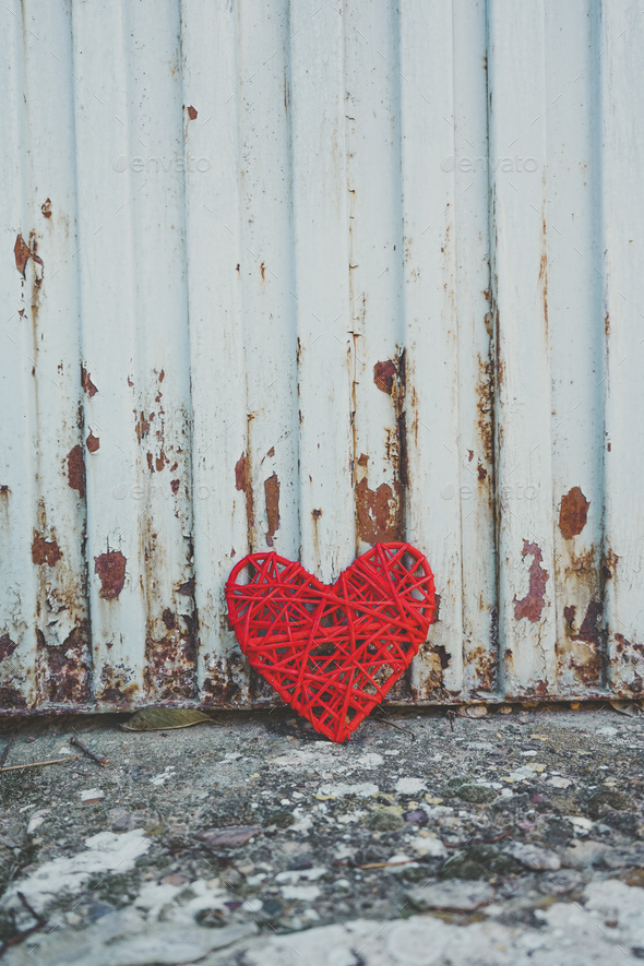 Grunge design of a red heart in an old wall - Stock Photo - Images