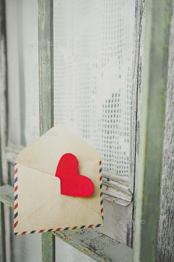Red heart inside an old envelope - Stock Photo - Images