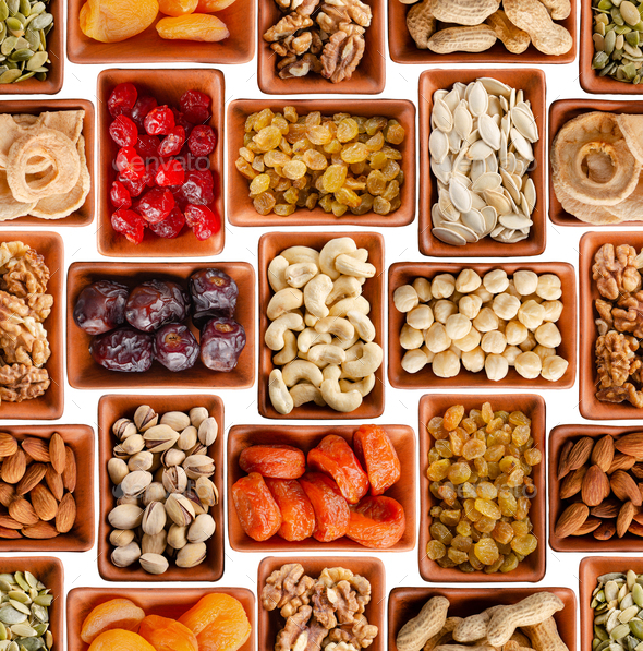 Seamless flat lay food background of dehydrated fruits, seeds and nuts on white - Stock Photo - Images