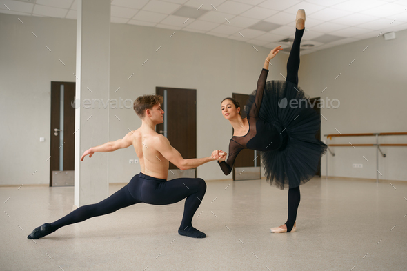 Female and male ballet dancers in action - Stock Photo - Images