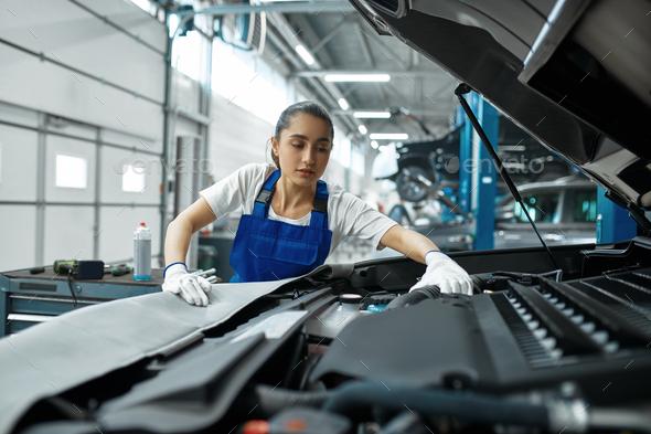 Female mechanic checks engine, car service - Stock Photo - Images