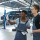 Two male mechanics talking in car service - PhotoDune Item for Sale