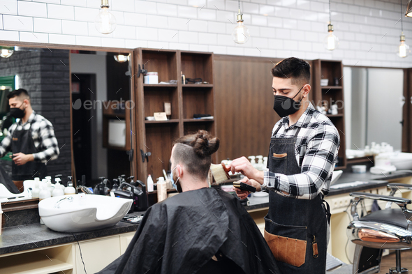 Man client visiting haidresser in barber shop, coronavirus and new normal concept - Stock Photo - Images