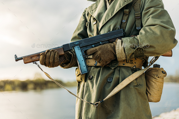 Soldier Of USA Infantry Of World War II Holds Submachine Weapon In Hands - Stock Photo - Images