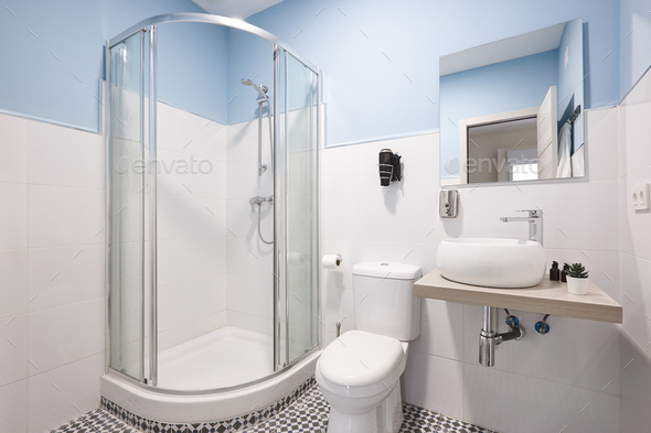 Bathroom with shower cabin, sink and basin. Modern apartment - Stock Photo - Images
