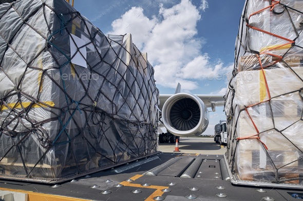 Loading of cargo containers to airplane - Stock Photo - Images