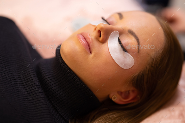 Woman With Cotton Pads Lying During Eyelash Extension Treatment - Stock Photo - Images
