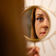 Young Woman Looking At Her Reflection In Beauty Clinic - PhotoDune Item for Sale
