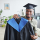 African American man holding graduaion gown - PhotoDune Item for Sale
