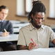 African student taking exam in college - PhotoDune Item for Sale
