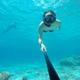 Underwater selfie shot with selfie stick. Deep blue sea. Wide angle shot. - PhotoDune Item for Sale
