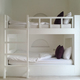 Clean hotel room with wooden bunk beds. Vintage effect style pictures. - PhotoDune Item for Sale