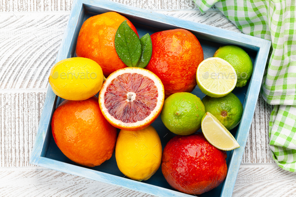 Various fresh citrus fruits in wooden box - Stock Photo - Images