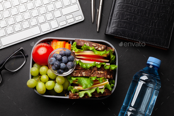 Healthy office lunch box with sandwich and fresh vegetables - Stock Photo - Images