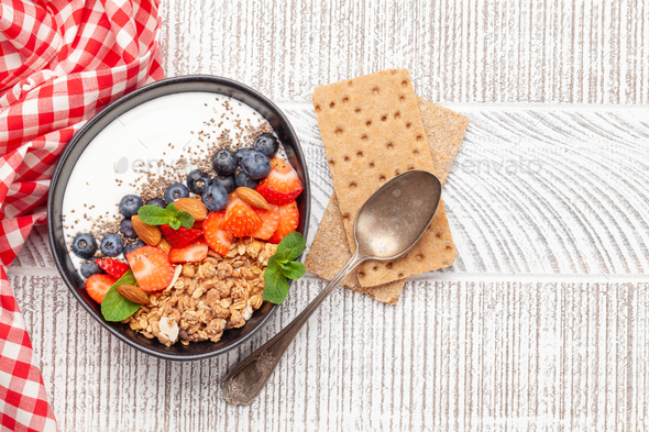 Healthy breakfast with bowl of granola, yogurt and fresh berries - Stock Photo - Images