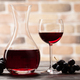 Wine decanter, glass of red wine and grapes - PhotoDune Item for Sale