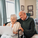Senior couple using laptop at home - PhotoDune Item for Sale