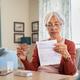 Senior woman checking medicine leaflet - PhotoDune Item for Sale