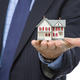 Male Real Estate Agent Holding Miniature House in Palm - PhotoDune Item for Sale