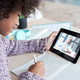 African child girl holding tablet talking with tutor on distance video call. - PhotoDune Item for Sale